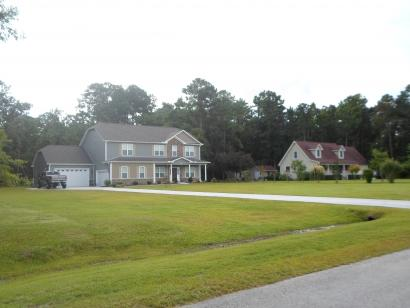 House to the LEFT of property